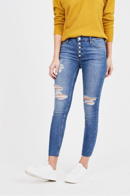 Distressed Mid Rise Skinny Jean